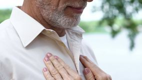 Hands of senior lady on man chest, long-awaited meeting, love relationship, care. Hands of senior lady on men chest, long-awaited meeting, love relationship royalty free stock image