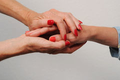 Hands of Senior mother and daughter Royalty Free Stock Photography