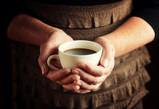 Hands of senior woman holding cup of coffee Royalty Free Stock Photo