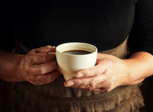 Hands of senior woman holding cup of coffee Royalty Free Stock Photography