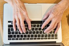 Hands of Senior Woman Typing stock photos