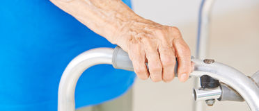 Hands of senior woman on a walker Royalty Free Stock Photos