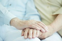 Hands of seniors Stock Photo