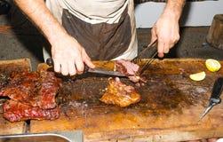 Hands served lamb steak Stock Images