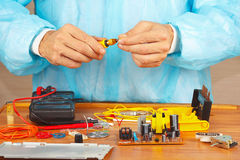 Hands service engineer of electronic equipment with screwdriver Royalty Free Stock Images