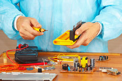 Hands service engineer of electronic equipment in service workshop Royalty Free Stock Photos