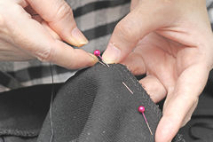 Hands sewing Stock Image