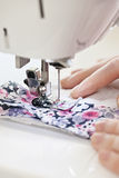 Hands with sewing machine Stock Photo