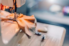 Hands of sewing process. Female hands stitching fabric on  machine. Hands of sewing process. Female hands stitching fabric on  machine hobby at home. blurred stock photography