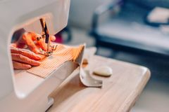 Hands of sewing process. Female hands stitching fabric. Hands of sewing process. Female hands stitching fabric on  machine hobby at home. blurred background stock images