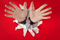 Hands in shackles Stock Photos
