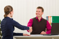 Hands shake between two successful business people Stock Images