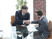 Hands shake between two successful business people Stock Image
