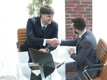Hands shake between two successful business people Stock Photo