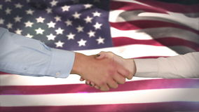 Hands shaking against american flag. Digital composite of Hands shaking against american flag stock footage