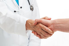 Hands shaking with doctor. A person shaking hands with a doctor Stock Images