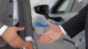 Hands shaking in front of the car stock video footage