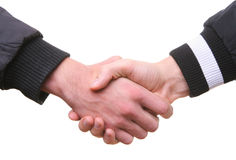 Hands shaking handshake. Isolated two male hands shaking handshake on white Royalty Free Stock Photography