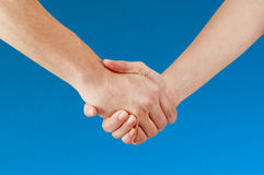 Hands shaking Stock Images