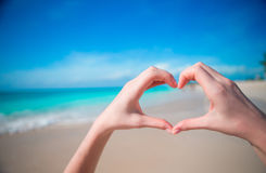 Hands in the shape of heart on the background of the Caribbean Sea Royalty Free Stock Images