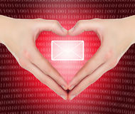 Hands in shape of a heart holding e-mail. Female hands in shape of a heart holding valentine\'s e-mail message Royalty Free Stock Photos