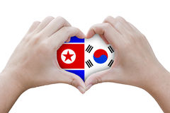Hands in the shape of heart with symbols of the flag of north an Royalty Free Stock Photo