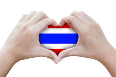 Hands in the shape of heart with symbols of the flag of Thailand Stock Photo