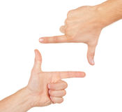 Hands shaped in viewfinder or frame. Isolated on white background stock photo