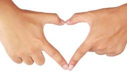 Hands shaping a heart. Stock Photos