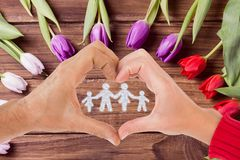 hands shaping heart holding family graphic Stock Photography