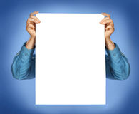 Hands in shirt holding a sheet of paper Royalty Free Stock Image