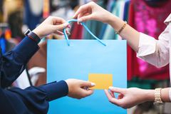 Hands with shopping bag and credit card close up. Stock Images