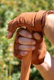 Hands on Shovel. Man's gloved hands resting on shovel Stock Image