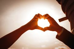 Hands of man and woman in shape of heart, wedding, valentine, love photo royalty free stock photo