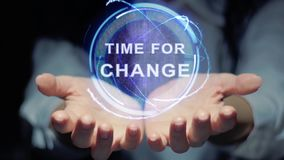 Hands show round hologram Time for change