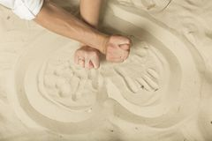 Hands showing figs newlyweds with rings on the sand. Just married. Happy couple Stock Images