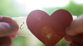 Hands showing love letter and then red heart. Confession of love. Valentines day video stock video