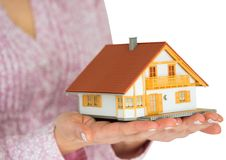 Hands showing a miniature model home Stock Photos