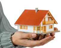 Hands showing a miniature model home Royalty Free Stock Photo