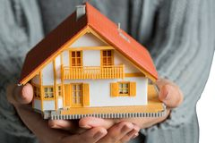 Hands showing a miniature model home Royalty Free Stock Photography