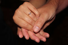 Hands showing off an engagement ring Stock Image