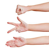 Hands showing rock paper scissors Royalty Free Stock Image