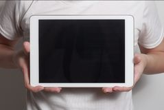 Hands showing tablet. A tablet is a wireless touch screen personal computer that is smaller than a notebook but larger than a smartphone stock photos