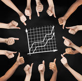 Hands showing thumbs up in circle over graph Royalty Free Stock Photography