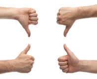 Hands showing thumbs up and down Stock Images