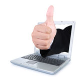 Hands showing thumbs up out of the laptop screen Royalty Free Stock Image