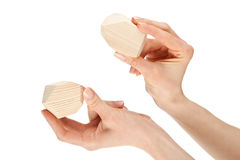 Hands showing two wooden blocks Stock Photo
