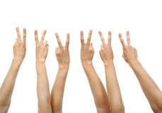 Hands showing victory sign. Isolated on white Stock Photo