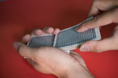 hands shuffle a deck of cards. Royalty Free Stock Photo