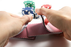 Hands shuffling cards royalty free stock photography